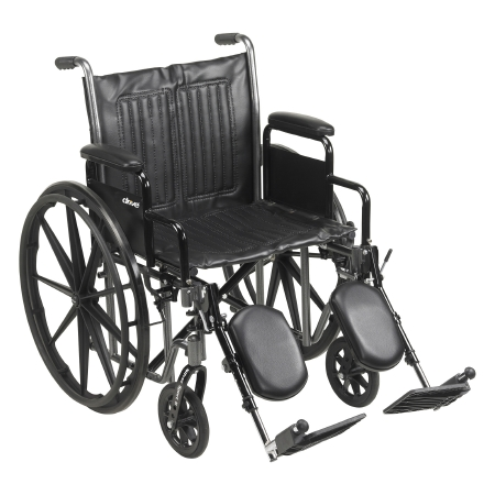 McKesson Standard Wheelchair with Padded, Removable Arm, Composite Mag Wheel, 20 in. Seat, Swing-Away Elevating Footrest, 350 lbs